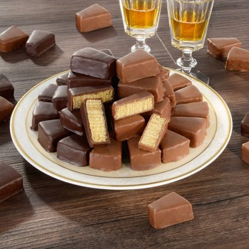 Baumkuchenspitzen mit Jamaica-Rum umhüllt mit Zartbitterschokolade  (15 Packungen pro Ktn.)